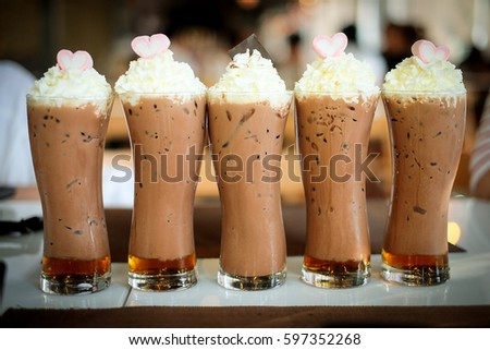 coffee with whipped cream, marshmallow and caramel topping