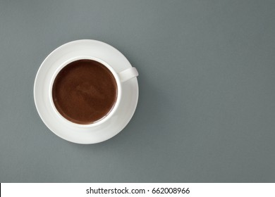 Coffee in white cup on gray background. Turkish coffee for breakfast.
