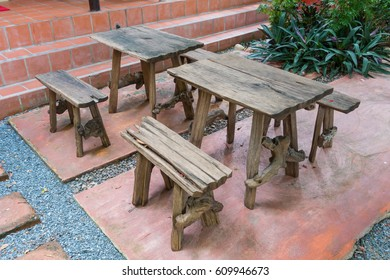 Coffee wooden table in the garden