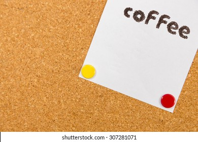 coffee word on paper on cork board with sticky note pinned