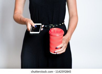coffee with you and a smartphone, business lunch on the way, female hands