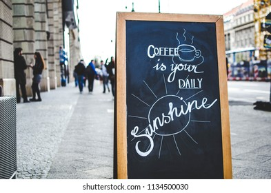 Coffee is your daily sunshine wooden board sign in the street