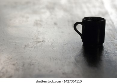 a coffeee cup on wood table