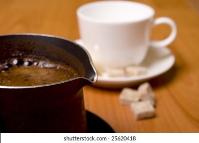 coffee-maker, cup and sugar on wooden table