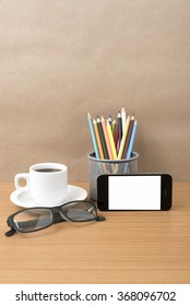 coffee,phone,eyeglasses and pencil on wood table background