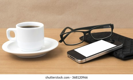 coffee,phone,eyeglasses and wallet on wood table background