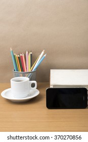 coffee,phone,stack of book and color pencil on wood table background