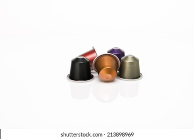 Coffee's capsule on white background with reflection