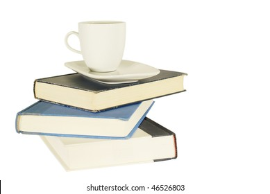 pile of hard covered books and coffee mug images stock photos