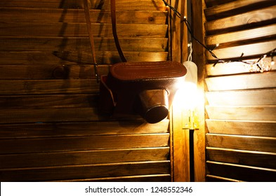 coffer from camera hanging on wooden background