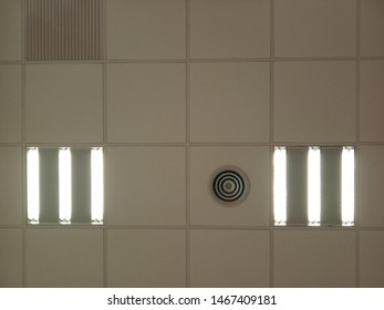 Coffered ceilings with parallel neon lighting and air conditioning outlet
