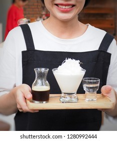 coffeshop lady is serving coconut coffee with smile