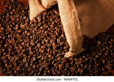 Coffew beans coming out of a sack ready to be dusted