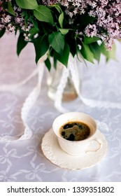 Coffie on the table with flowers on background