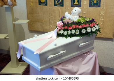 A coffin for a child with a flower arrangement