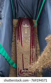 coffin in grave. the coffin in grave is dusted with earth. funeral in orthodox traditions