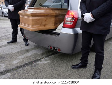 coffin inside funeral wagon