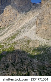 Coffin skilift on steep rises to mountain pass in the Dolomites Alps, Italy