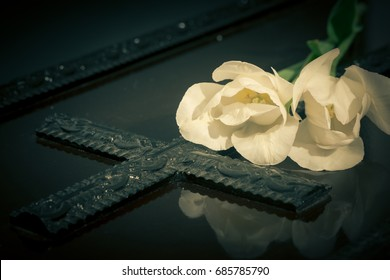 Coffin with white flowers
