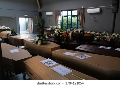 Coffins of COVID-19 victims are marked with a 'Biohazard' warning sign as they are placed next to each other at the Pompes Funebres Fontaine funeral service company in Gilly, Belgium, 09 April 2020.