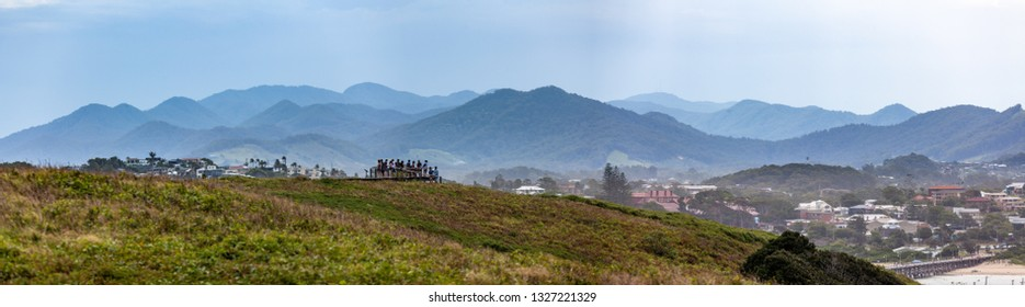Coffs Harbour, Australia - January 1, 2019: Panoramic landscape of Muttonbird island viewing platform and mountains. Coffs Harbour, New South Wales, Australia
