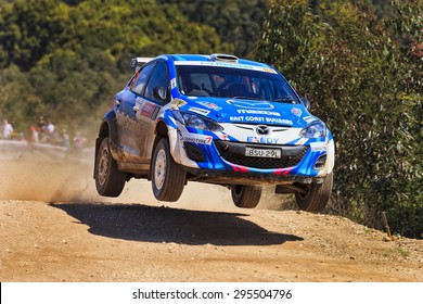 COFFS HARBOUR, AUSTRALIA - SEPTEMBER 14, 2014: Australian crew B. Reeves World Rally in a Mazda 2 RS WRC 2014 race super stage during Australian World Rally Championship