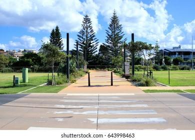 Coffs Harbour city street view of Pedestrian crossing or Zebra crossing. Image of Australian street or Australian road. Suburban street in Australia.
