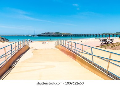 Coffs Harbour, NSW, Australia- December 20, 2017 : Australian coastal sand beach at Coffs Harbour, Australia, one of the most popular family holiday destinations in New South Wales, Australia.