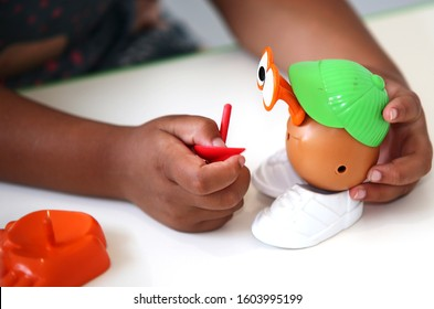 Coffs Harbour, NSW / Australia - Jan 2nd 2020 - a speech pathology session with a child playing with a Mr Potato Head toy as a way of building language skills