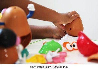 Coffs Harbour, NSW / Australia - Jan 2nd 2020 - a child playing with a Mr Potato Head toy as part of a speech therapy session