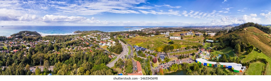 Coffs Harbour regional town on Australian Mid North coast of NSW - the big banana town at the centre of banana palm farms and agriculture industry. Wide aerial panorama over suburbs and coast.