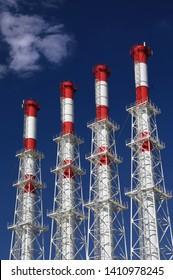 Cogeneration Plant Funnels And Blue Sky Background