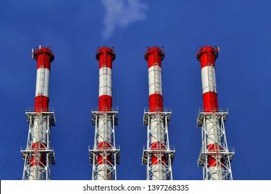 Cogeneration Plant Funnels On Blue Sky Background