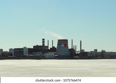 Cogeneration plant on the bank of a city pond. City landscape. Russia, April, 2018.