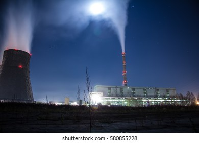 Cogeneration plant towers in moon light.