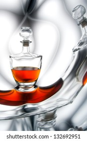 Cognac in bottle or whiskey with reflection