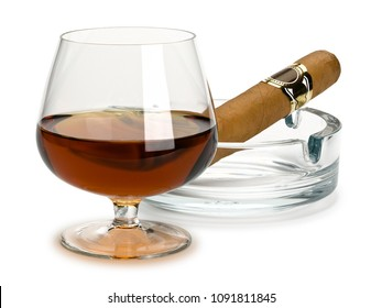 Cognac and cigar in a glass ashtray it is isolated on white