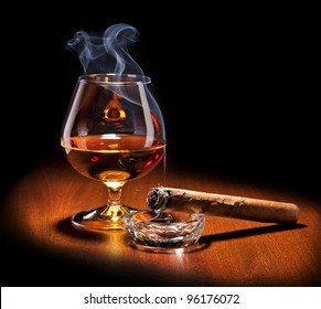 Cognac and Cigar with smoke  on black background