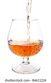 cognac in a classic glass isolated on a white background