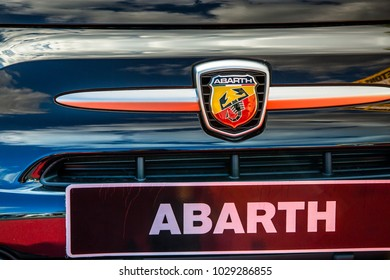 Cognac, France - August 30, 2016: Tight map on the front of a fiat model Abarth car with logo of the brand, chrome grille and name of the brand written on the license plate