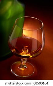 Cognac glass and bottle