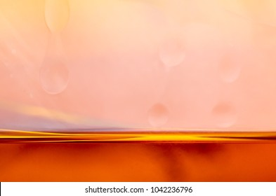Cognac in the glass. Horisontal line abstract. Macro unfocussed. Blured background.