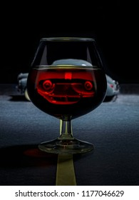 Cognac glass on a road, where you see an inverted image of a car, simulating an accident.