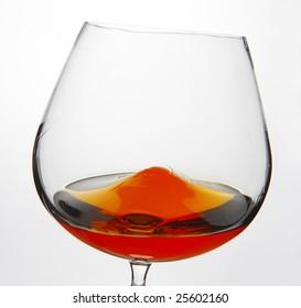 Cognac Snifter glass with liquid inside
