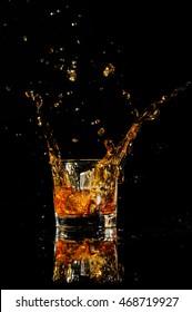 cognac splashing with ice