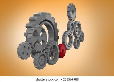 Cogs and wheels against orange vignette