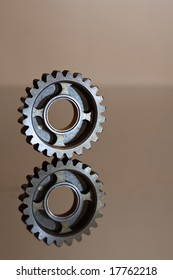 Cogwheel on a polished to a shine steel surface