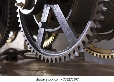 cogwheels in the clock Old mechanism of a big tower clock