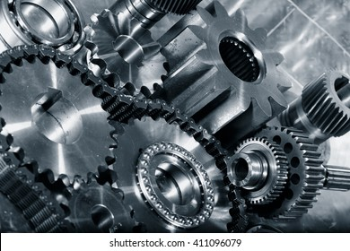 cogwheels and gears in titanium, aerospace engineering parts in a metal toning concept
