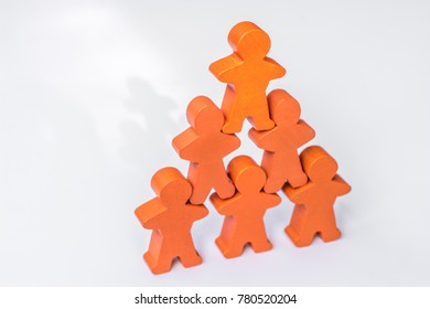 Cohesion and solidarity in the company presented with orange wooden figures on white background